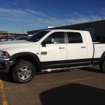 White truck with black bed liner coated wheel flare in Edmonton