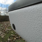 Close up of white spray on bedliner on bumper
